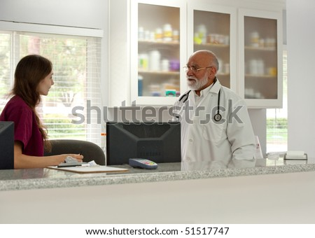 a vet speaks to his assistant - stock photo