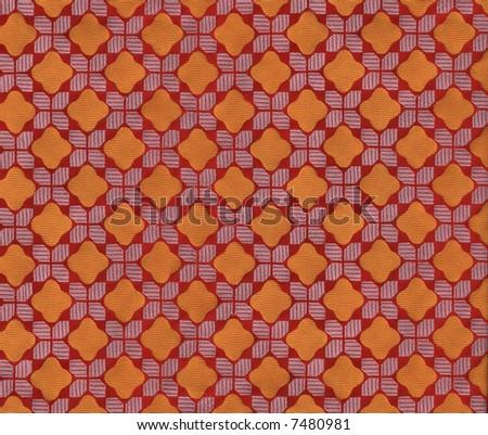 A vibrant retro textile pattern of orange diamonds - stock photo