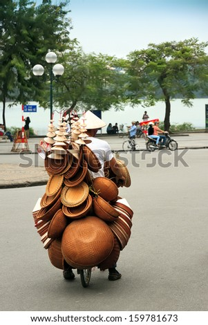 A vietnamese bicycle vendor in HANOI, VIETNAM - stock photo