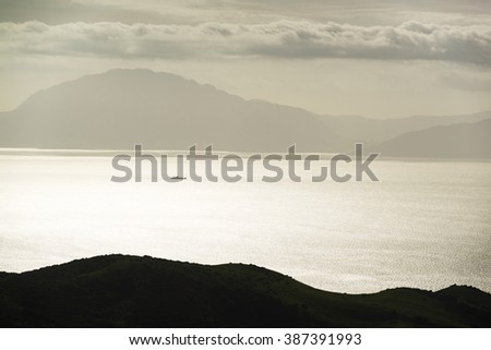 A view across the Strait of Gibraltar taken from the hills above Tarifa. Andalusia. Spain - stock photo