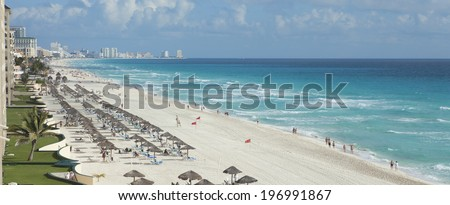 A view along the beach of the Caribbean Sea and hotels in Cancun, Mexico - stock photo