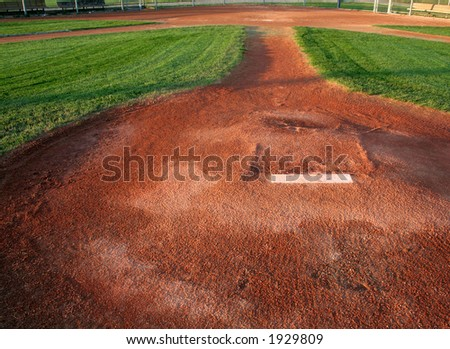 A view from directly behind a pitchers mound. - stock photo