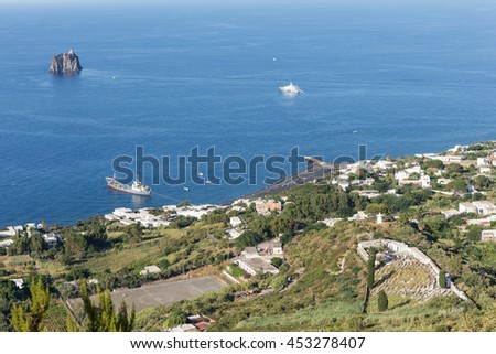A view from Stromboli to the harbor and Strombolicchio Aeolian Islands -  Italy - stock photo