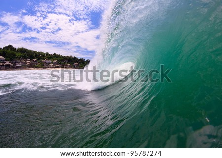 A view from the side of the barreling wave - stock photo
