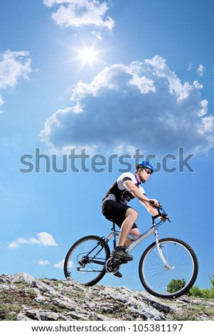 A view of a bicyclist riding a mountain bike downhill style - stock photo