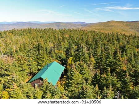 A view of a cabin from the Balsam Lake Mountain fire tower in early autumn in the Catskills Mountains of New York - stock photo