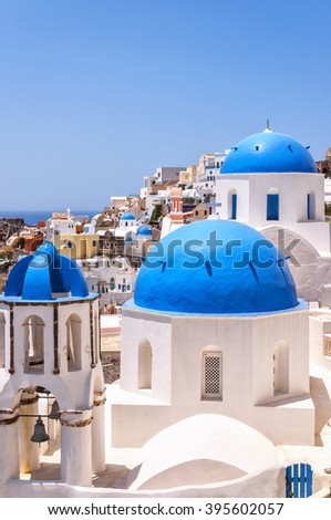 A view of a couple of the famous blue domed churches from Oia on the greek isle of Santorini. - stock photo