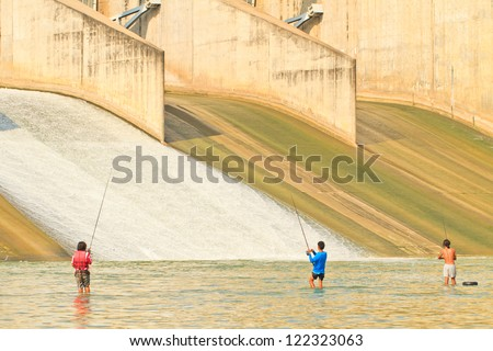 A view of a fisherman fishing on a PASAK Dam background, Thailand - stock photo