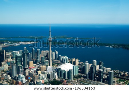 A view of a modern coastal city's downtown from above. - stock photo