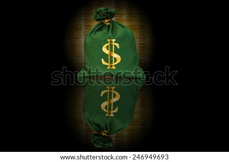 A view of a money bag with US dollar sign against of coins black background - stock photo