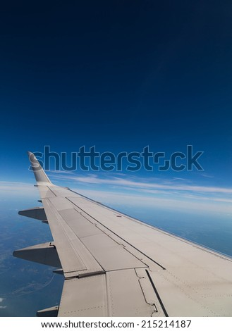 A view of a plane with with a clear blue sky and copy space - stock photo