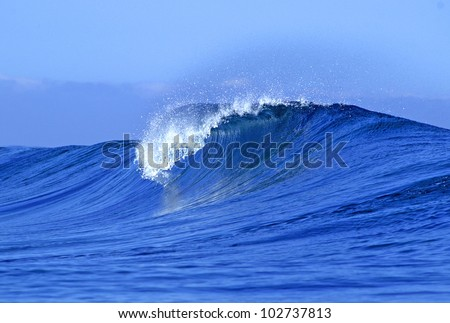 A view of a scenic blue ocean wave in Fiji - stock photo
