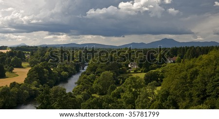 A view of a Scottish landscape with the Highlands in the far - stock photo