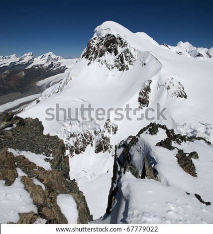 a view of a snowcovered mountain in the swiss alps - stock photo