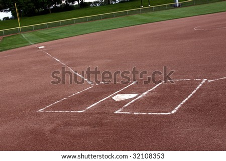 A view of a softball diamond at dusk. - stock photo
