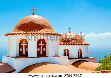 A view of a typical church with red roof on Greek island, Kalymnos, Greece - stock photo