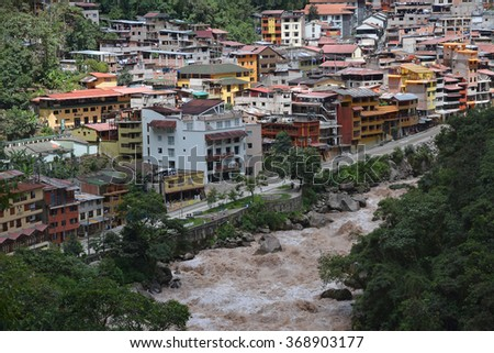 A view of Aguas Calientes in the valley below Machu Picchu.This is where most tourists stay when visiting the Machu Picchu - lost city of the incas.  - stock photo