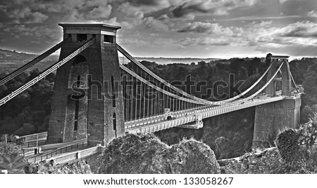 A view of Clifton suspension bridge spanning across Avon Gorge near Bristol in black and white. The bridge was designed by Isambard Kingdom Brunel and completed in 1864 - stock photo