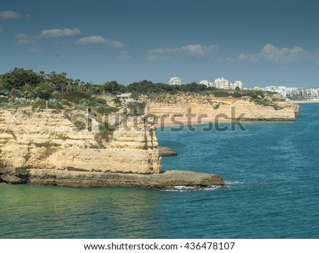 A view of coast Algarve near city Armacao de Pera in the south of the country, Portugal, 2016 - stock photo