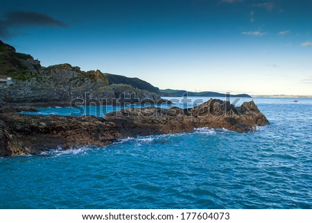 A view of Cornish Rock Formation along the coastline from Mevagissey. - stock photo
