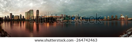 A view of downtown Vancouver, British Columbia from False Creek. - stock photo