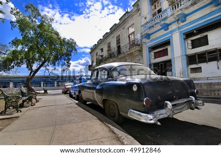 A view of havana street with classic vintage american car, cuba - stock photo