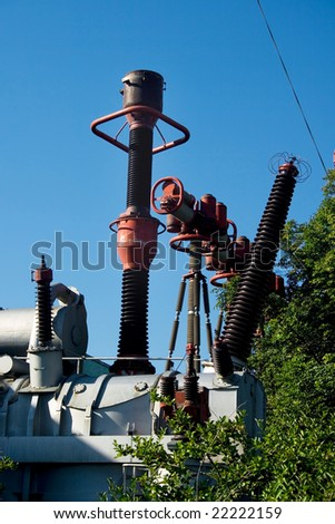 A view of high-voltage electric transformator devices - stock photo