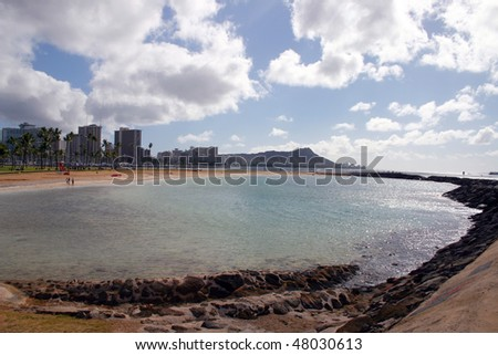 A view of Honolulu city from beach in Hawaii. - stock photo