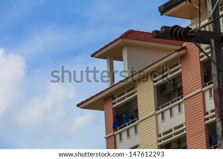 A view of hotel facade with modern style and blue sky. - stock photo