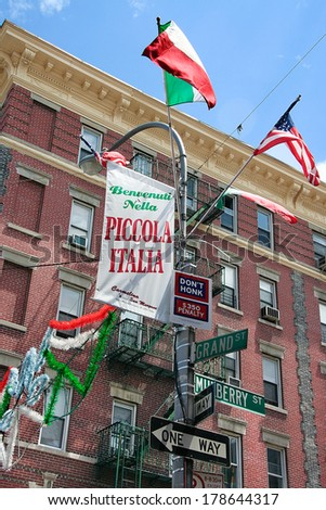 A view of Little Italy flags on Mulberry Street in New York City - stock photo