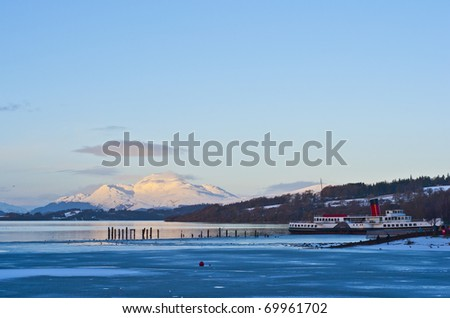 A view of loch lomond with paddle steamer in the foreground - stock photo