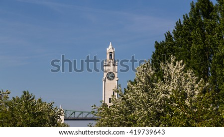 A view of Montreal Clock Tower (Tour de l'Horloge) during the day. Trees can be seen near the Tower - stock photo