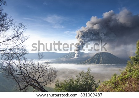 A view of Mount Bromo, East Java in Semeru Tengger National Park, Indonesia during eruption. - stock photo