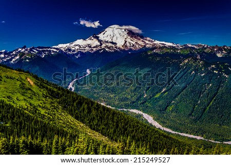 A View of Mount Rainier from Crystal Mountain with a River Valley. - stock photo