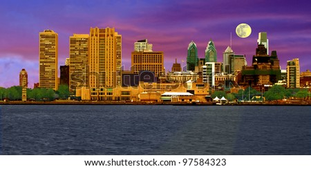 A view of Philadelphia, Pennsylvania's skyline at dusk for a colorful cityscape comprised of various commercial buildings. - stock photo