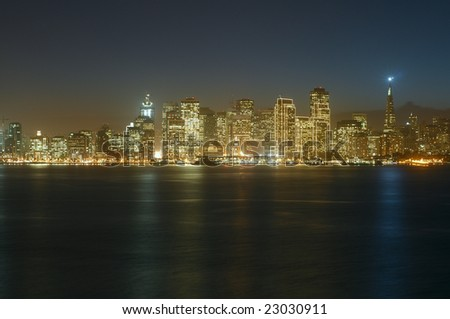 A view of San Francisco downtown at dusk (shot from Treasure Island). This illumination is on only for Christmas and New Year (~1.5 months per year). Copyspace on top and bottom - stock photo