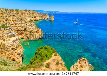 A view of sea bay with kayaks and boats on turquoise water at Ponta da Piedade, Algarve region, Portugal - stock photo