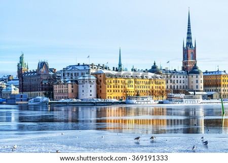 A view of Stockholm's gamla stan region from across the frozen river in winter time. - stock photo