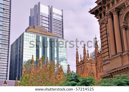 A view of Sydney Cathedral, highrise office buildings and part of Town Hall on an autumn day - stock photo
