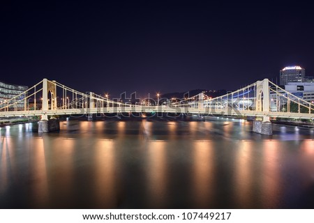 A view of the Andy Warhol Bridge overlooking the Allegheny River in Pittsburgh, Pennsylvania at night - stock photo