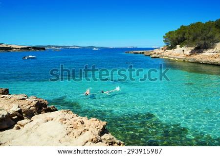 a view of the beautiful Cala Gracioneta beach in San Antonio de Portmany, in Ibiza Island, Balearic Islands, Spain - stock photo