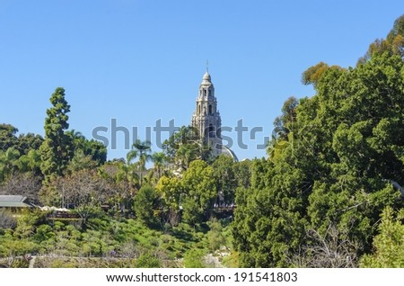 A view of the bell tower of the historic museum of man in the Balboa park gardens in San Diego, southern California, United States of America. A park filled with outdoor recreational activities. - stock photo