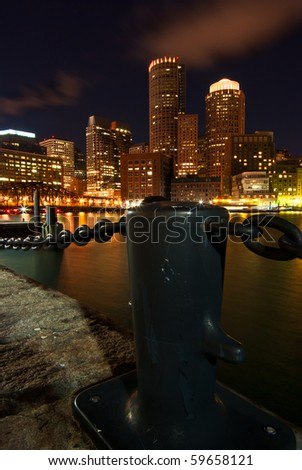 A view of the Boston skyline from Rowe's Wharf at night - stock photo