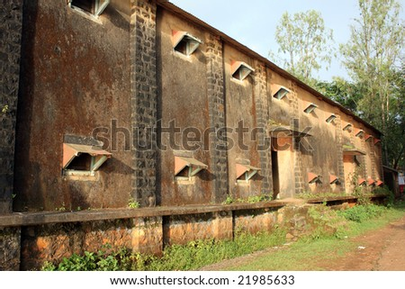 A view of the building of an closed old factory in India. - stock photo