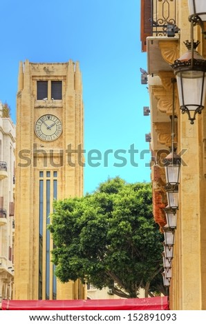 A view of the clock tower in Nejme Square in Beirut, Lebanon and some local architecture. A landmark of the beautiful and picturesque city centre in downtown Beirut.  - stock photo