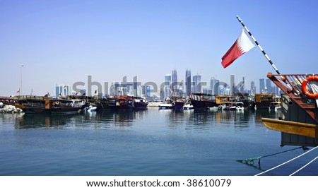 A view of the dhow harbour in Doha, Qatar, October 9, 2009, with the high rise area under development in the background - stock photo