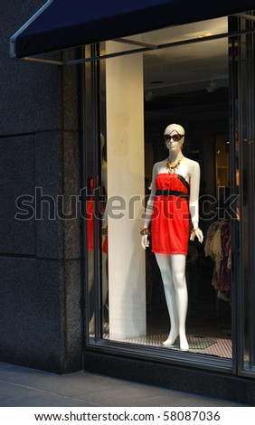 A view of the display window from a clothing store - stock photo