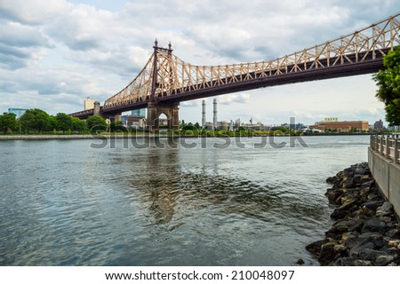 A view of the Ed Koch Queensboro Bridge over the East River looking towards Long Island City. - stock photo