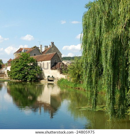 A view of the famous white wine village Chablis, France - stock photo