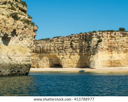 A view of the forsaken boat near the Algarve coast in Portugal, 2016 - stock photo